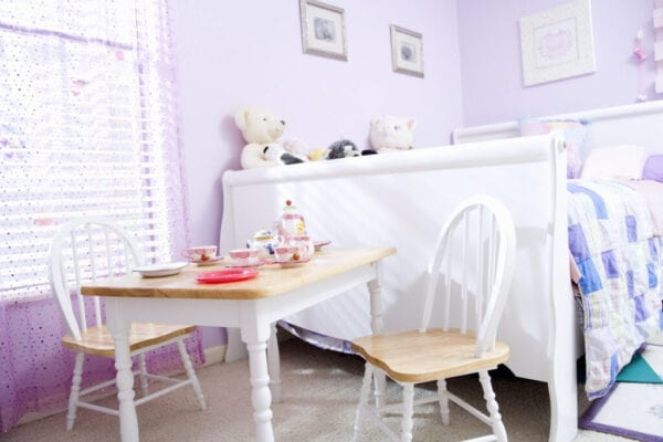 little girls bedroom with tea party set up