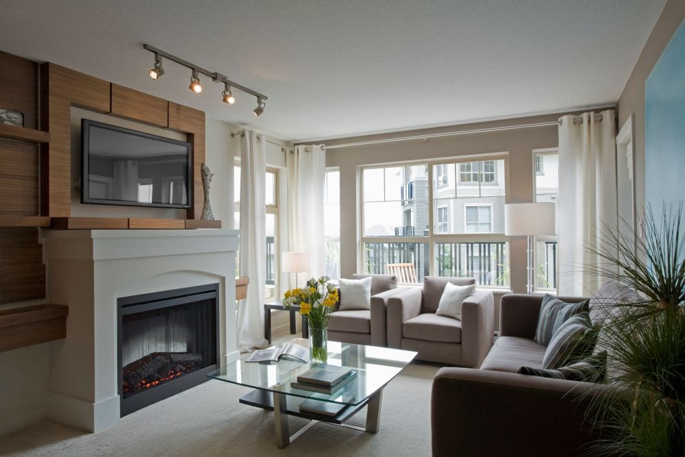 Modern living room with mounted tv above fireplace