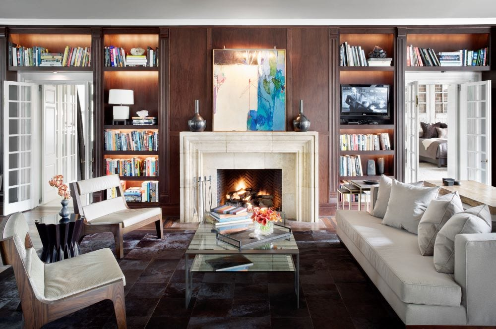 Living room with fireplace as focal point, bookshelves and art as decor