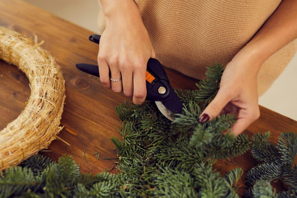 Florist making a Christmas wreath