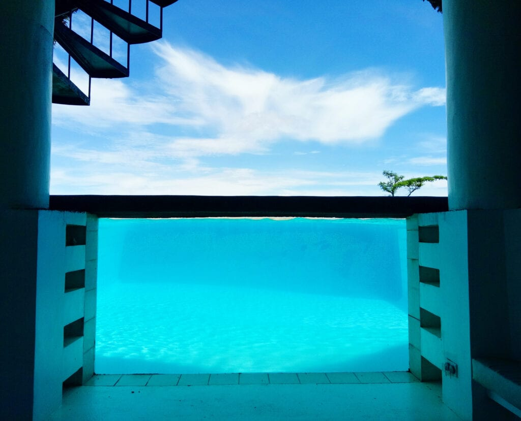 Glass wall of a pool