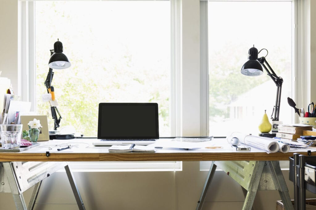 Computer and lamps on desk