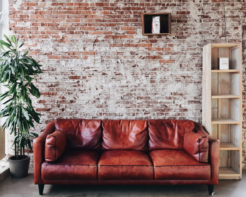 brick wall leather couch