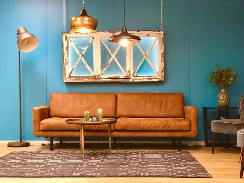 leather couch and rustic mirror