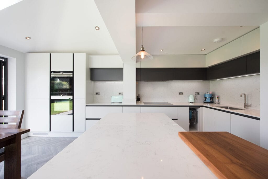 A general view of a an open plan kitchen diner with large island counter within a home