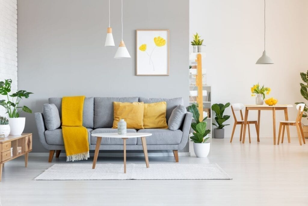 Gray and white living room with mustard yellow accents