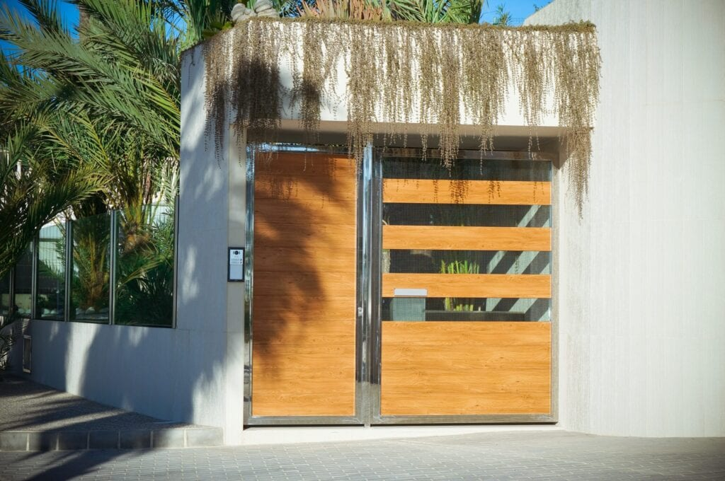 Big wooden and crystal entrance door of a big modern house