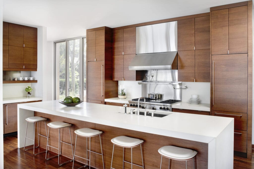 Modern kitchen with breakfast bar and stainless appliances