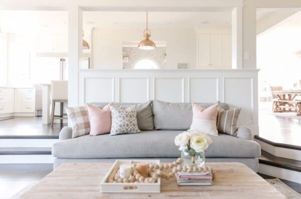 interior white sitting room and kitchen