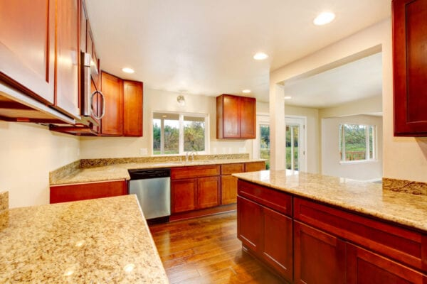 Nice wooden kitchen room interior with granite counter tops , hardwood floor and white ceiling. Northwest ,USA