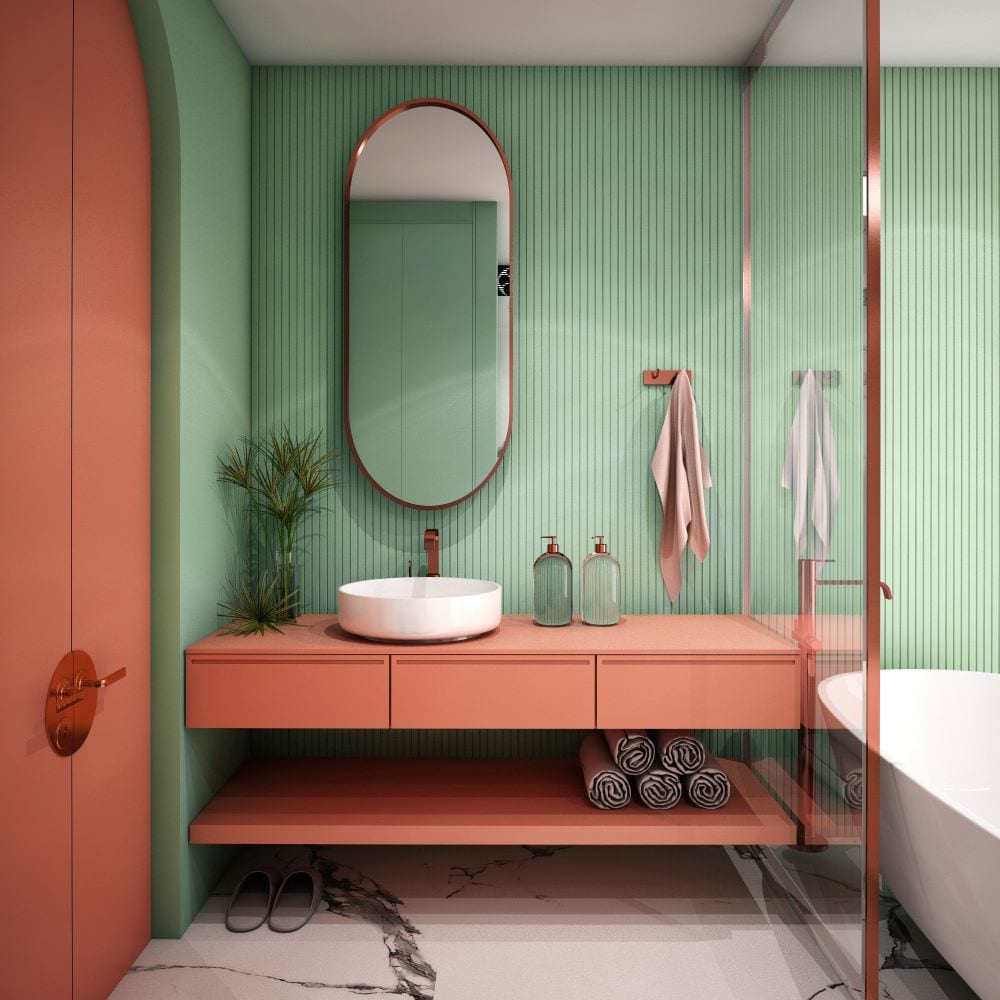 Bathroom sink and counter with green wall