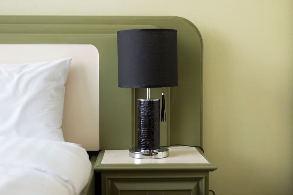 Bedroom with matching green headboard and nightstand