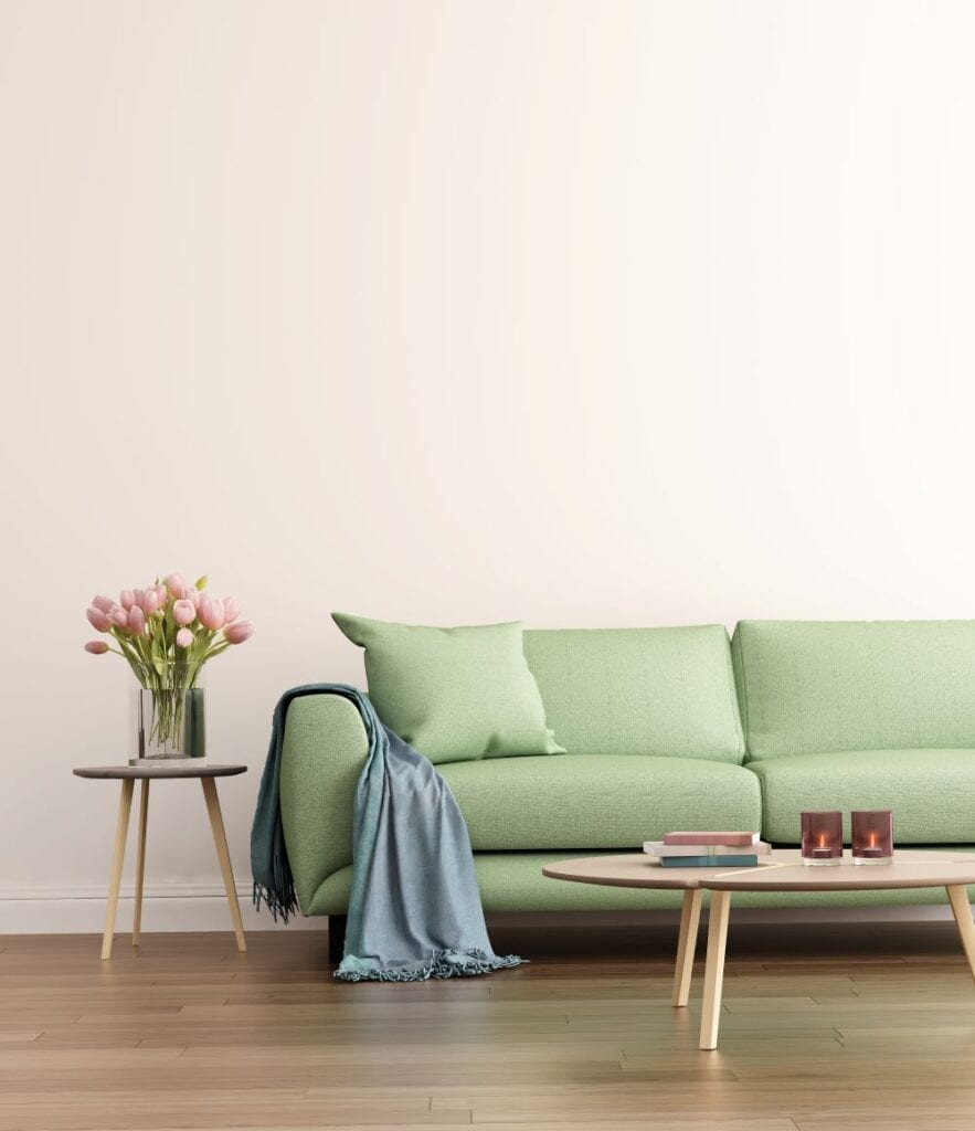 Sage green couch in neutral living room
