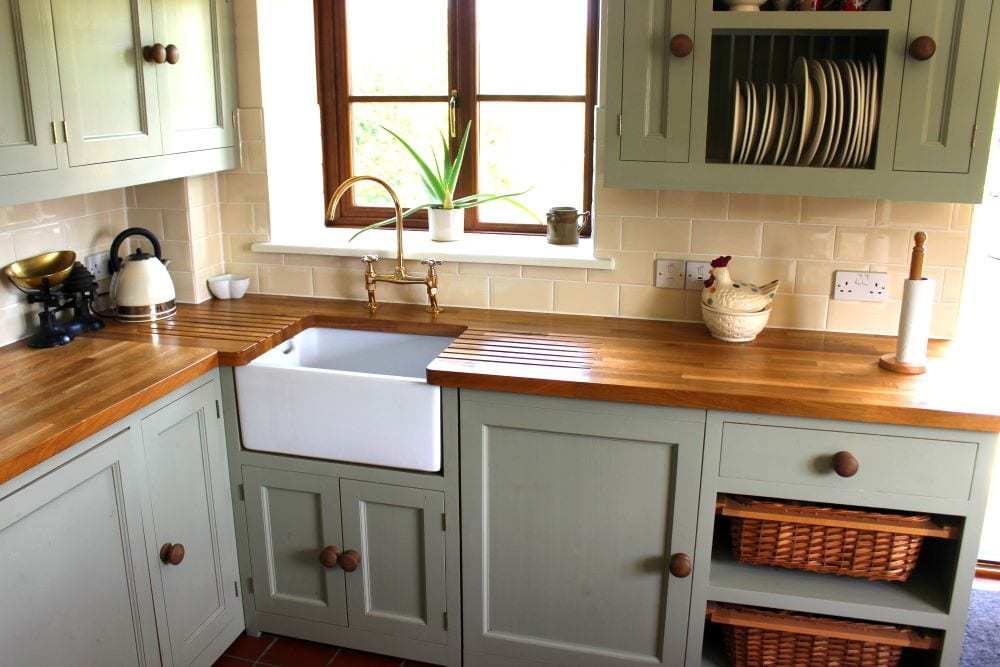 Closeup of green cabinets in kitchen