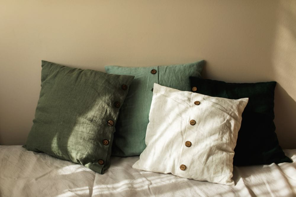 Pillows with mixed shades of green and white
