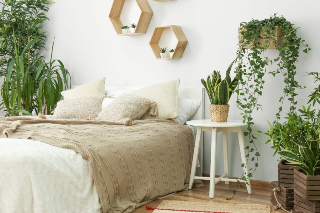 Bedroom filled with indoor plants, homemade boxes used as planters