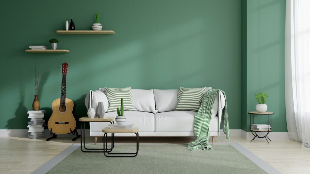 white couch with green patterned accents