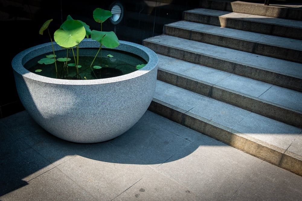 Ceramic pot with plants, garden water feature