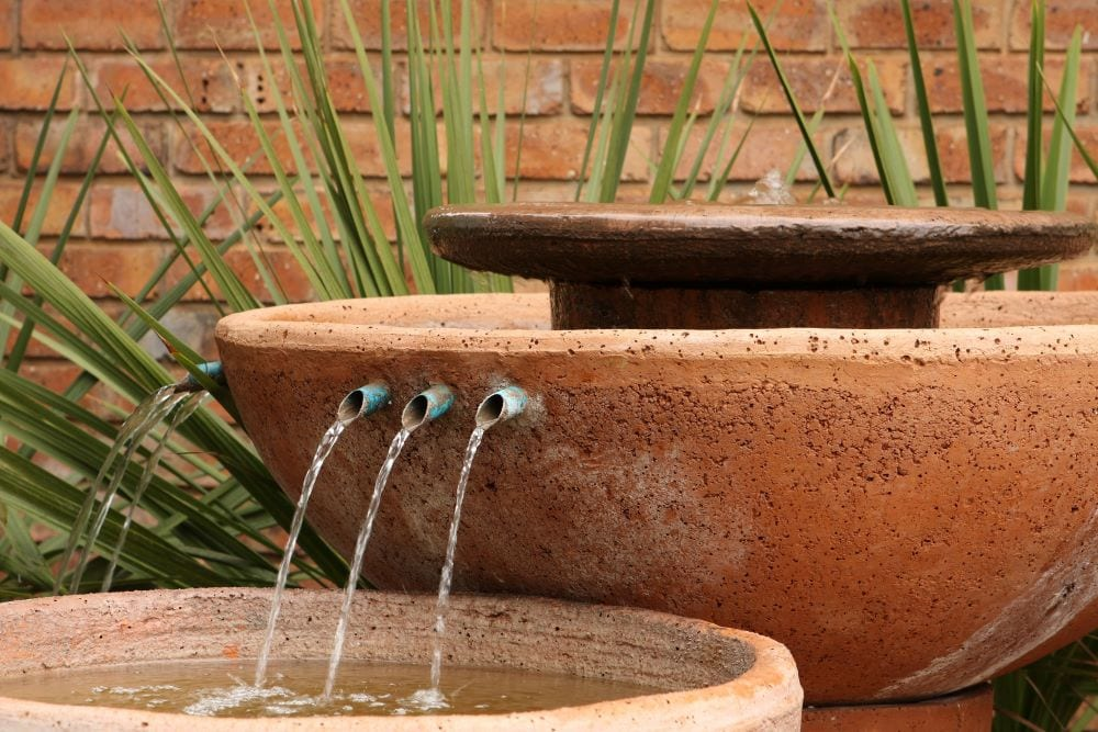 Stone vessel water feature with 3 spouts