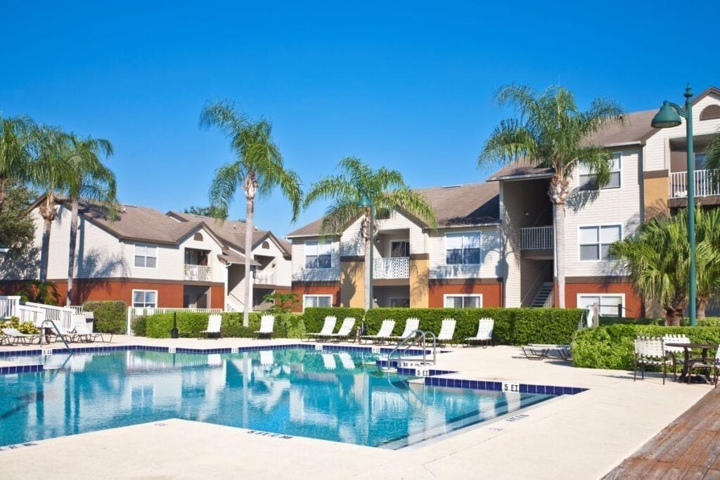Apartment complex with swimming pool amenities