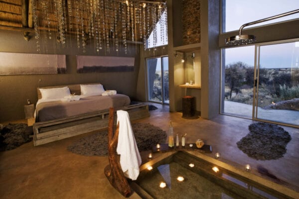 Luxury lodge bedroom interior with sunken bath in Namibia, Africa