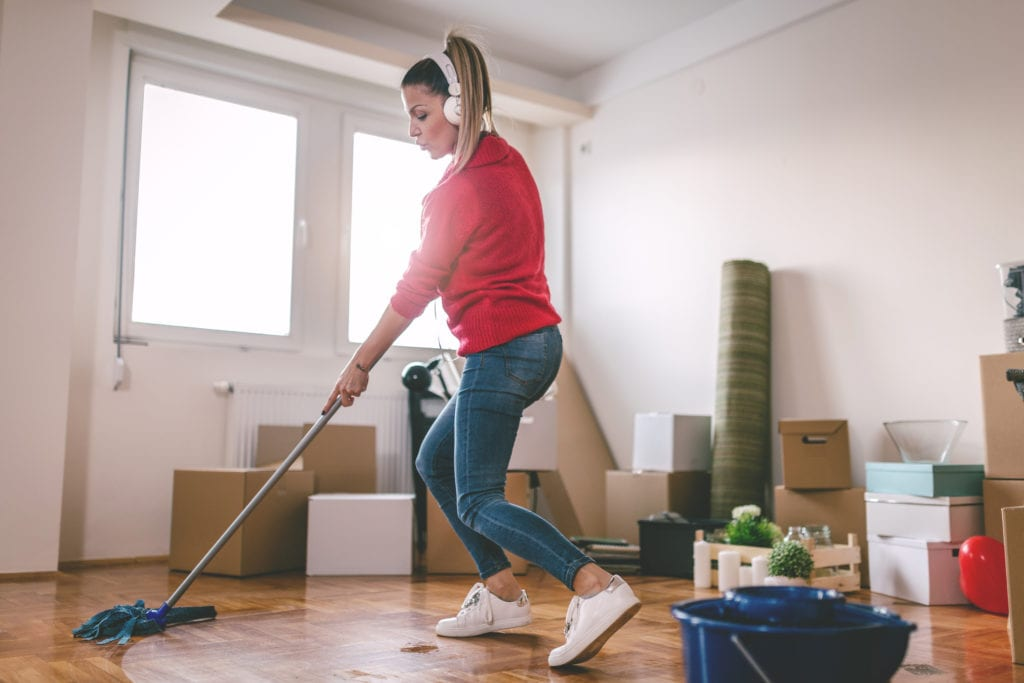 Woman cleans new apartment
