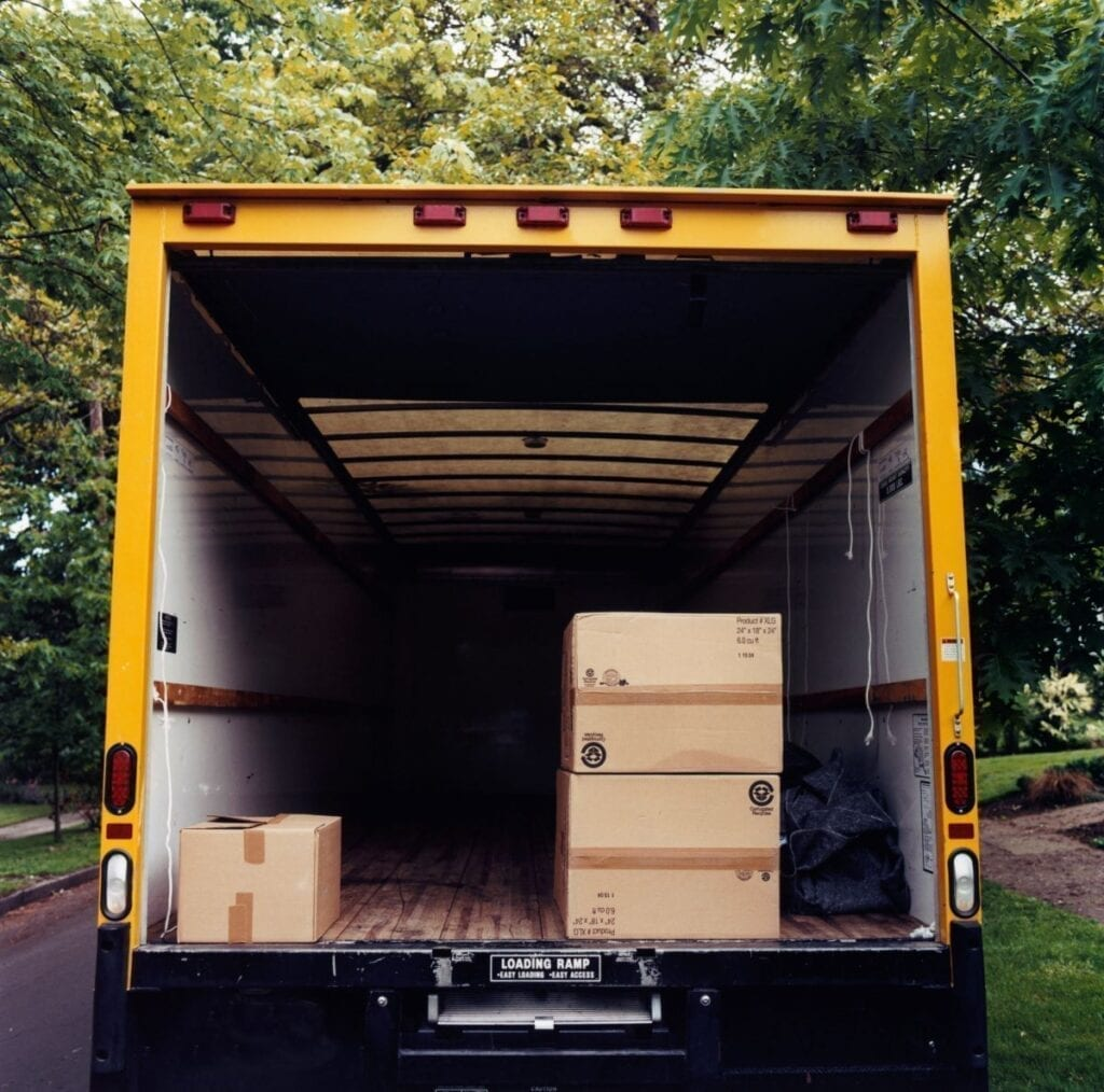 Boxes inside moving truck, packing open moving truck