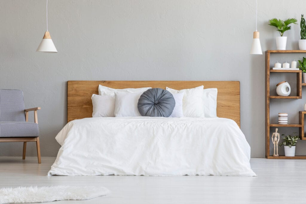 bed with wood headboard