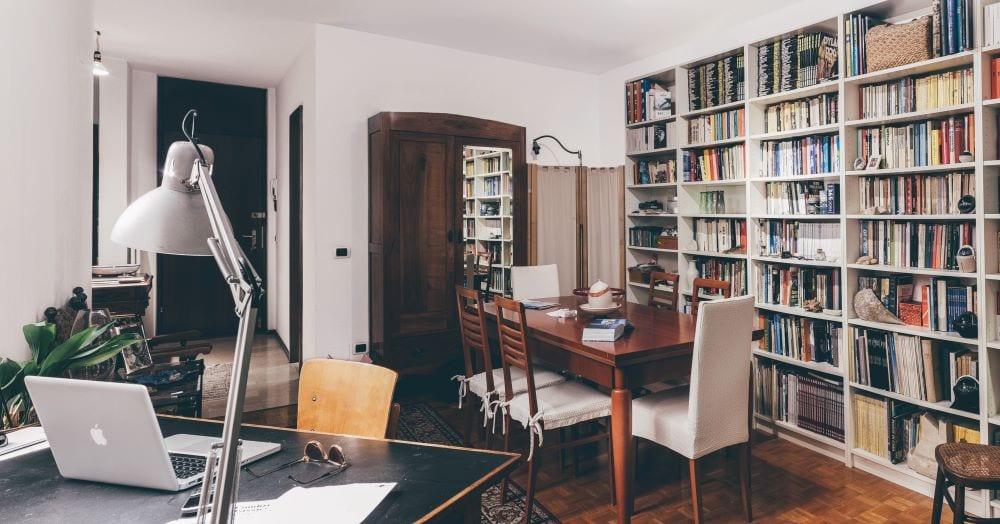 Living room with full wall of bookshelves