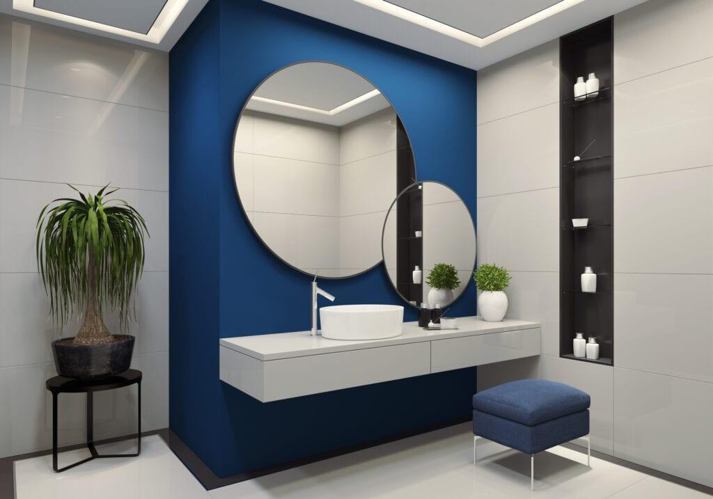 Dark blue accent wall in bathroom