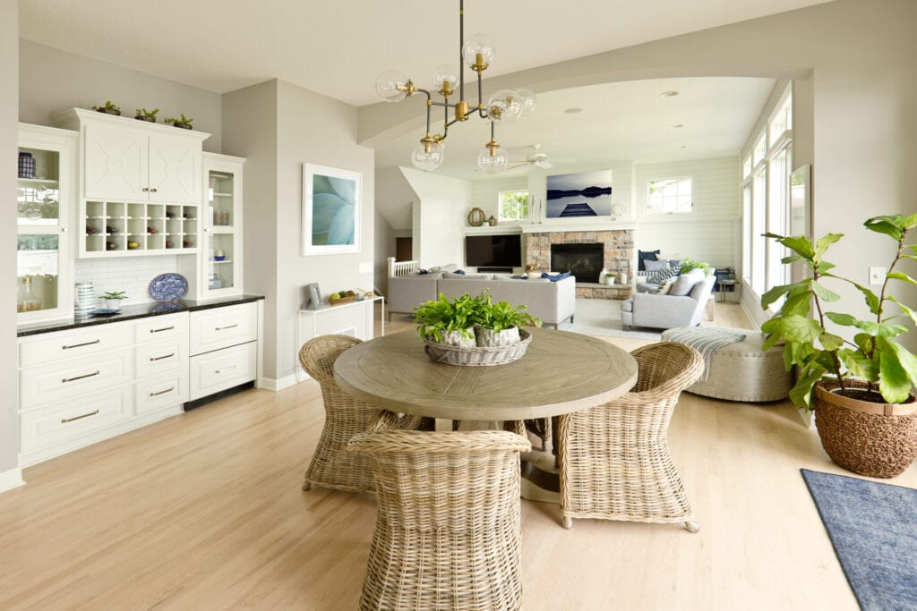 +++NOTE TO INSPECTOR: Two photos artwork on the wall are taken by me, they are currently in the iStock collection, see property release.+++ A contemporary kitchen and living room with open concept design and bar counter in a modern home. A beautiful view to the lake in the exterior.
