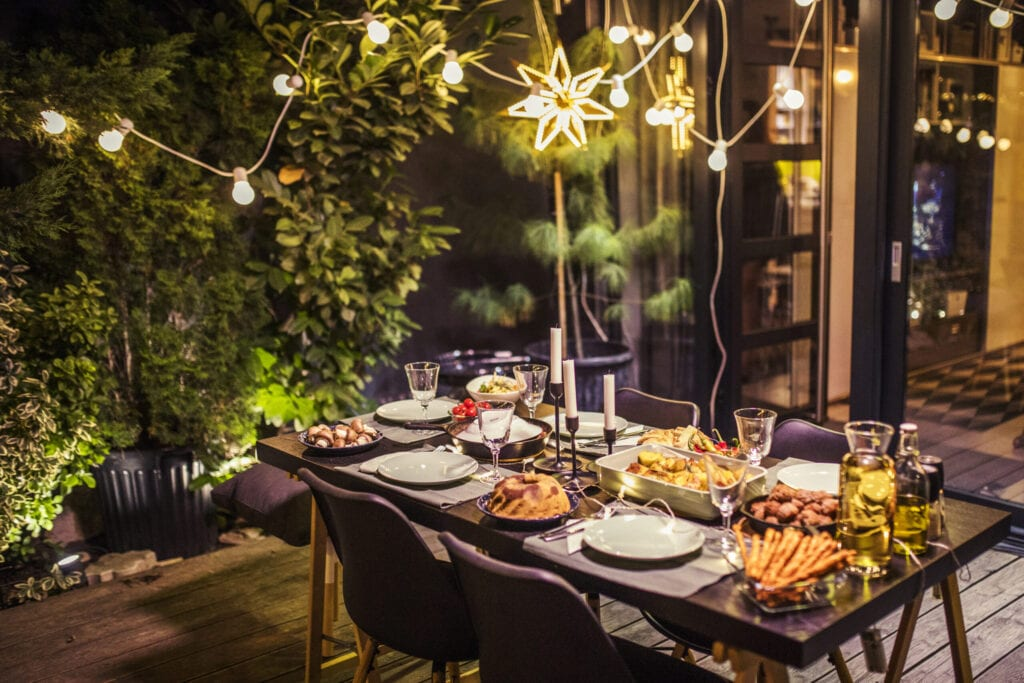 Table ready for dinner party at house backyard