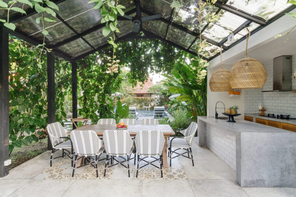 Outdoor dining space with greenery