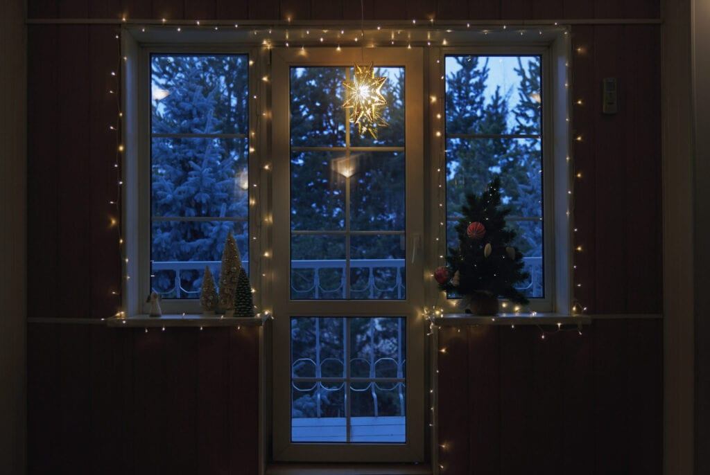 Christmas tree and string light at the window