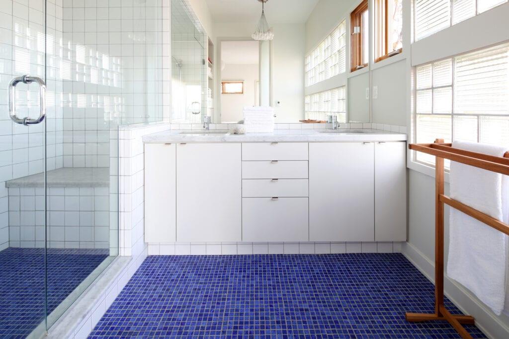Bathroom with blue tiled floor