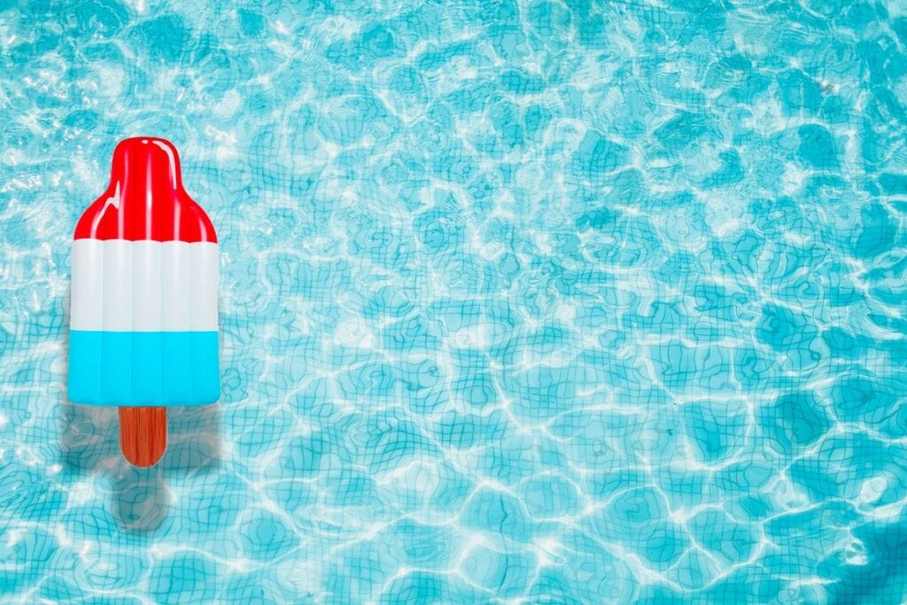 Red, white, and blue popsicle-shaped pool float
