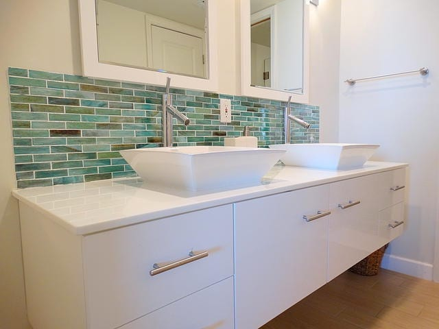 Teal tiled bathroom