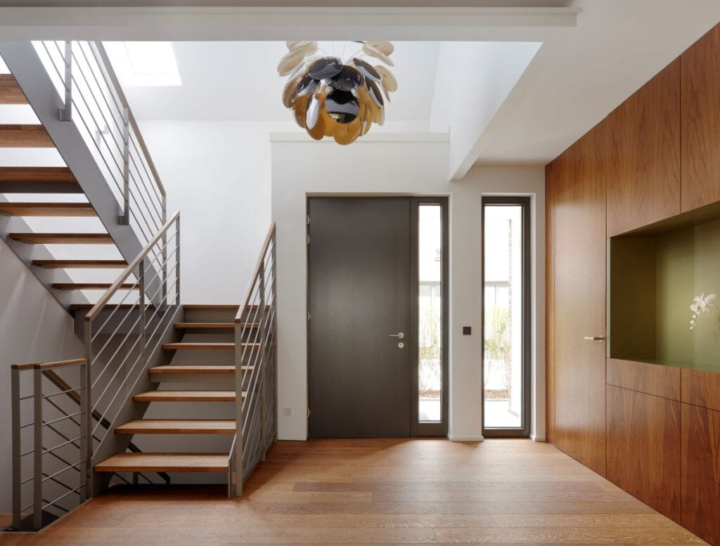 Modern foyer with staircase and unique chandelier