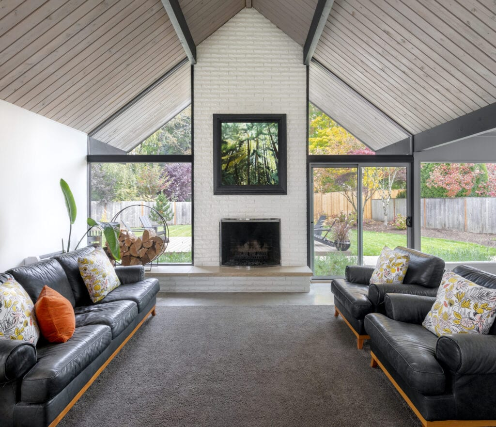 interior space of a mid-century modern house with big windows that allows natural light