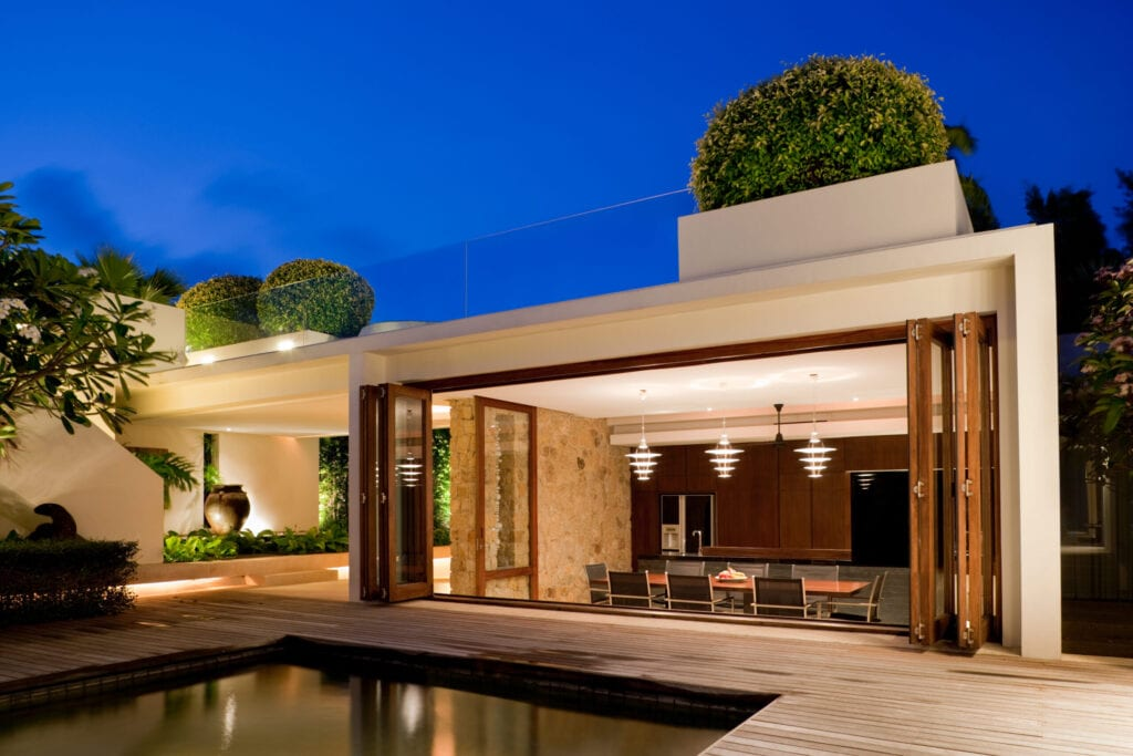 Luxury Tropical Modern Island Home Exterior With Swimming Pool.