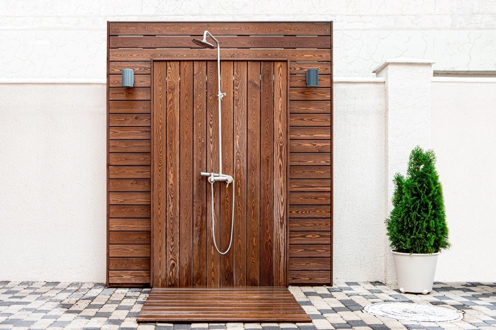 Outdoor shower finished with wood deck paneling