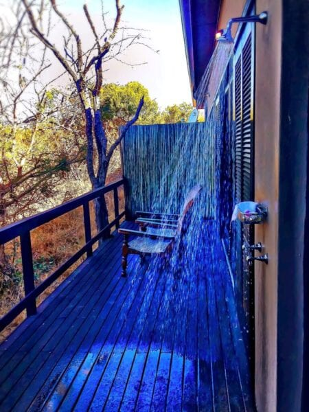 Outdoor shower on deck on the side of a house