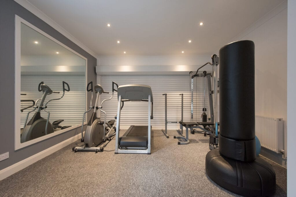 A general interior view of a home gym with various exercise machines