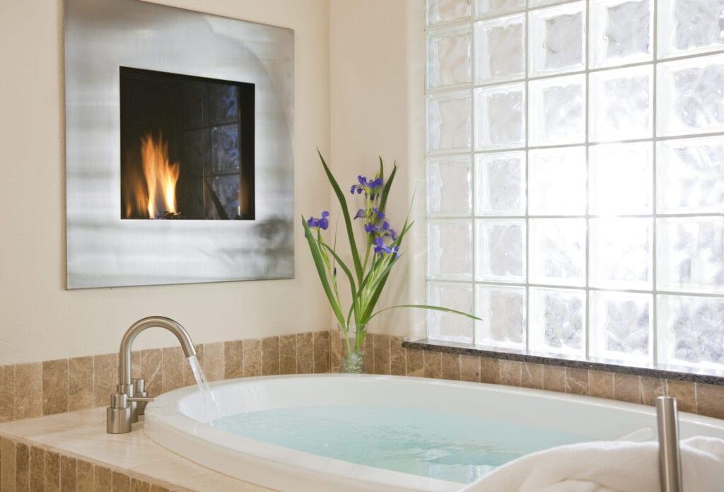 Bathtub in luxury inn with fireplace, Inn on Lake Granbury, Granbury, Texas, USA