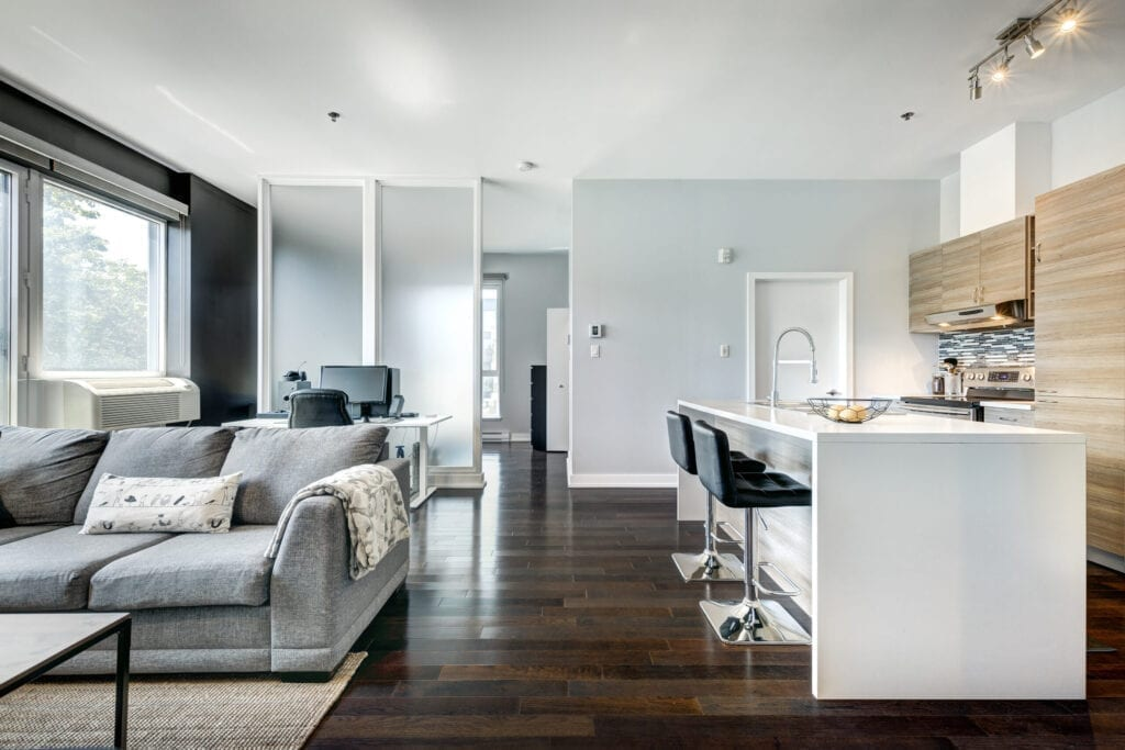 Interior of the well staged modern condominium in Montreal with the common areas, gym, pool, backyard