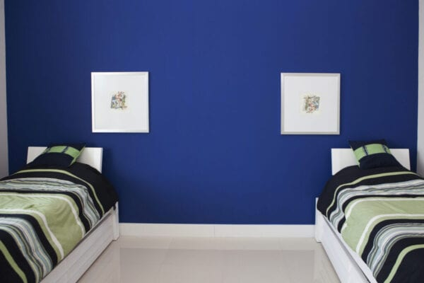 Wall art and twin beds in modern bedroom
