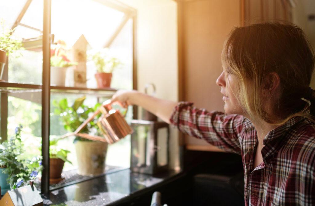 woman watering her herbs