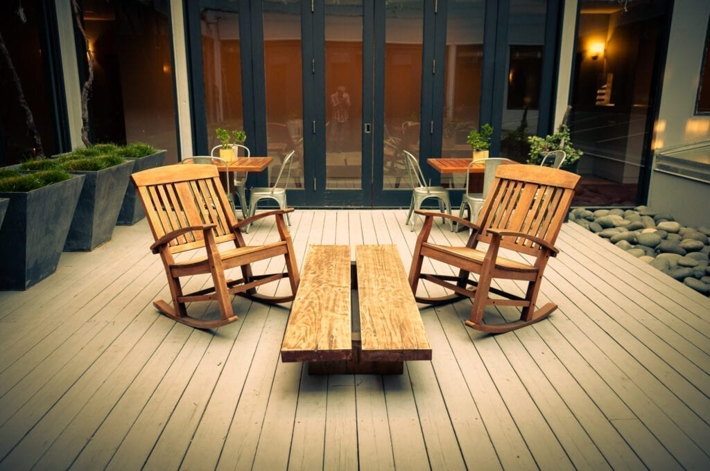 Rocking chairs on the second floor deck of Hotel Healdsburg, Healdsburg, CA, with a glimpse of yours truly.