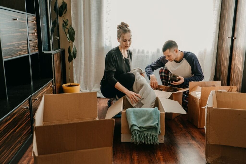 Couple is busy packing boxes to prepare for a move