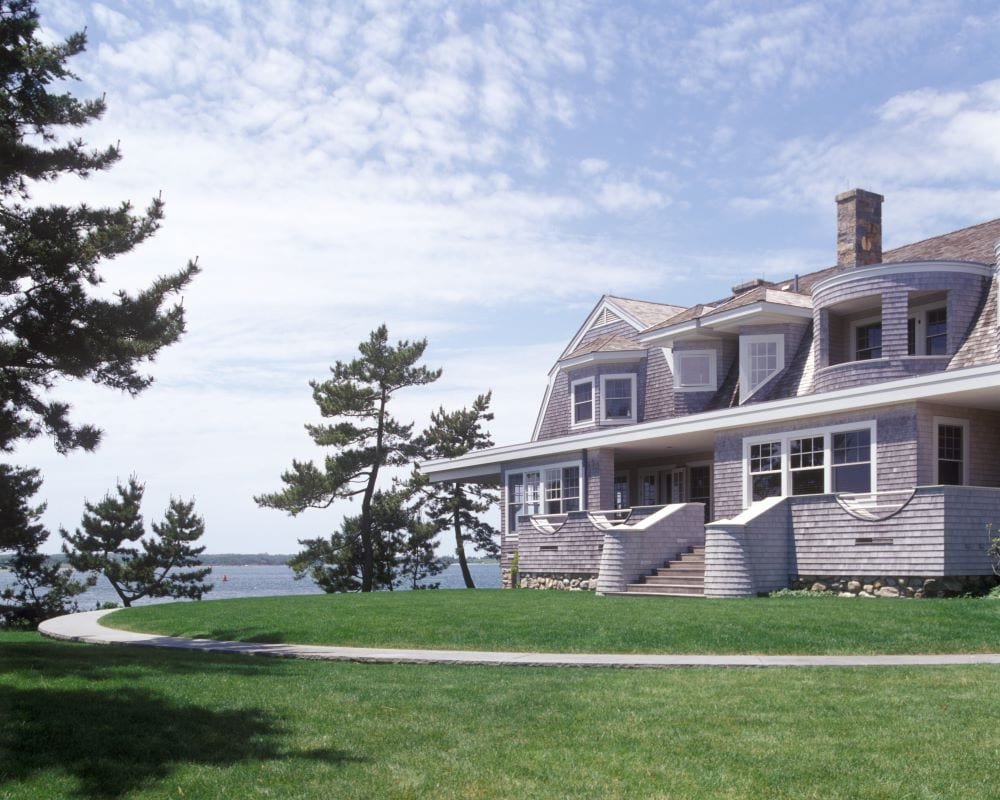 Exterior photo of Cape Cod style mansion